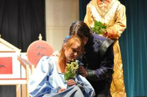 "Dan Clark, Cory Hall, and Christine Boyce as ""Laertes,"" ""Ophelia,"" and ""Claudius"" in ""Hamlet"""